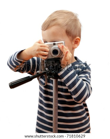 Pretty boy shooting with camera - isolated on white - stock photo