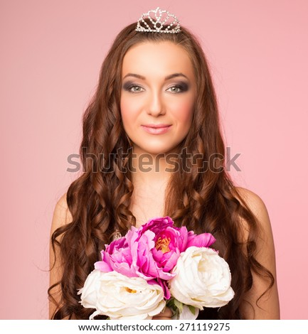 pretty bride in the studio on a pink background with a bouquet in the hands - stock photo