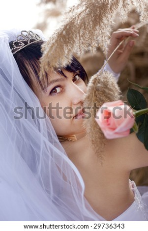 pretty bride with rose and reed