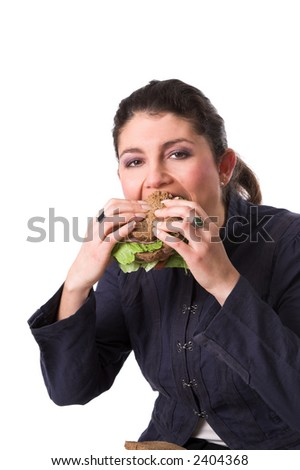 Pretty brunette enjoying her healthy whole grain sandwich