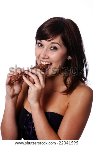 Pretty brunette girl eating a large chocolate bar