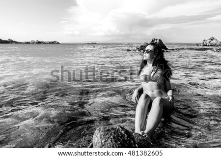Pretty brunette girl relaxing in the water