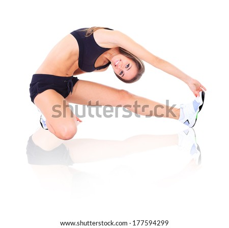 pretty brunette in black active wear on white background