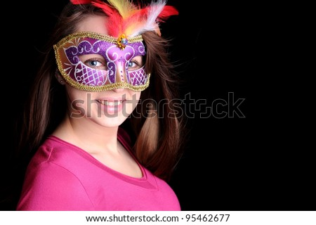 Pretty brunette in carnival mask - stock photo