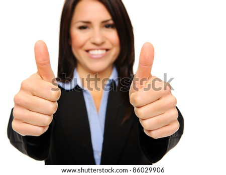 Pretty brunette in formal business attire giving the thumbs up, focus on hands isolated on white - stock photo