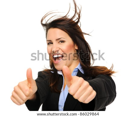 Pretty brunette in formal business attire giving the thumbs up with hair movement, isolated on white - stock photo