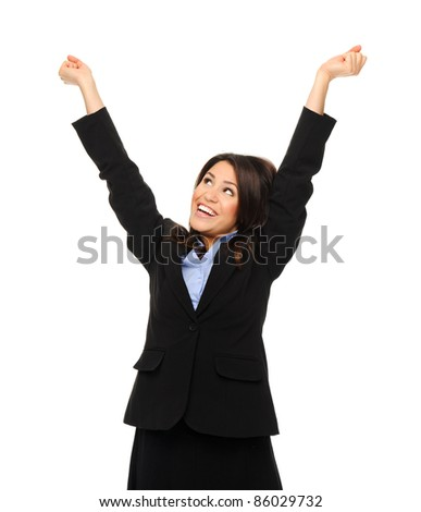 Pretty brunette in formal business attire raises her arms up in excitement