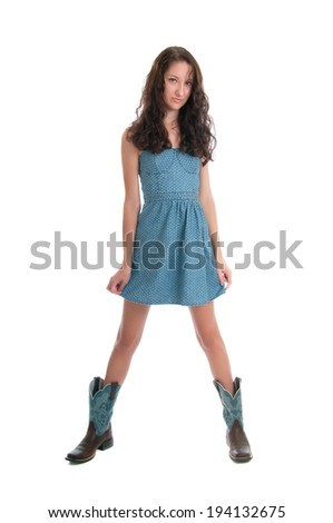 Pretty brunette in short dress and cowboy boots. Isolated against a white background - stock photo