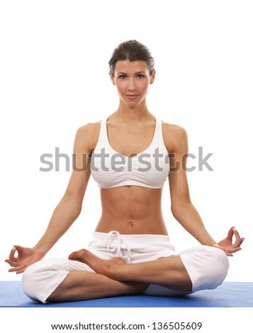 pretty brunette is exercising yoga on white background - stock photo