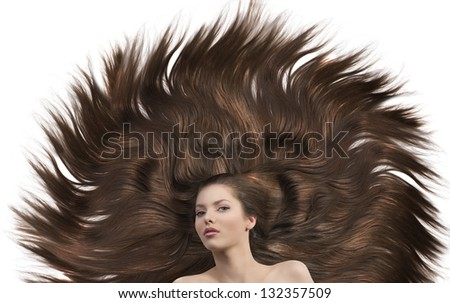 pretty brunette lying on her long brown hair laying down having a creative hairstyle