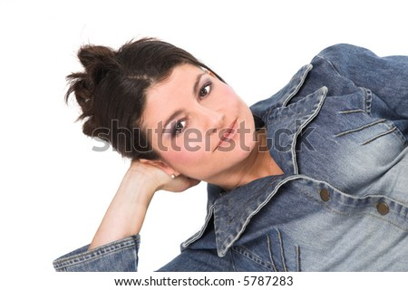 Pretty brunette lying relaxed in a casual look - stock photo