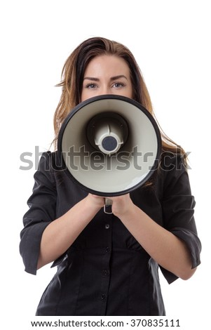 Pretty brunette office worker holding a loud speaker infront of her face.