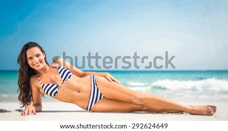 Pretty brunette posing at the beach on a sunny day