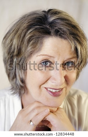 Pretty brunette senior lady portrait - stock photo