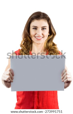 Pretty brunette showing a card on white background - stock photo
