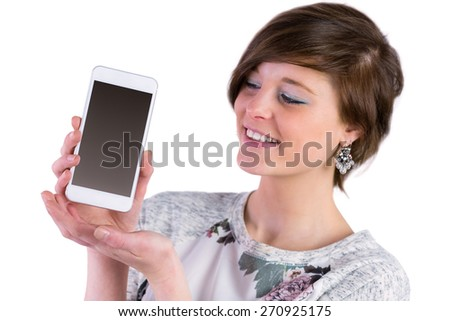 Pretty brunette showing her smartphone on white background - stock photo