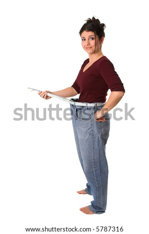 Pretty brunette showing how much weight she has lost - stock photo
