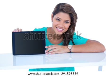 Pretty brunette showing tablet computer on white background