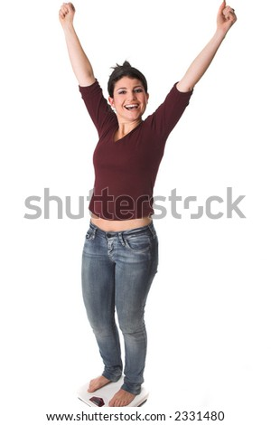 Pretty brunette stretching her arms in the air after having hit her target weight