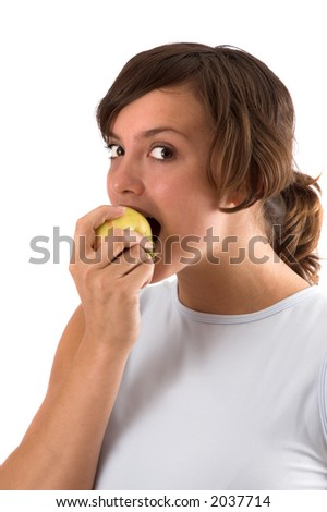 Pretty brunette taking a big bite out of a healthy apple