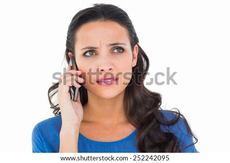 Pretty brunette talking on the phone on white background - stock photo