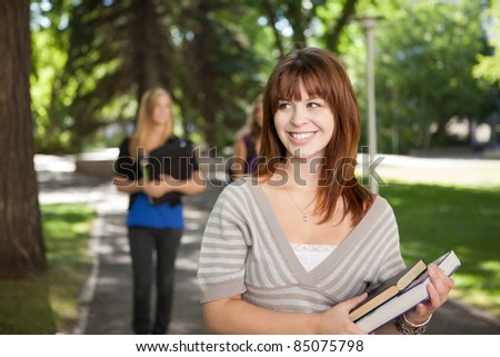 Pretty brunette university girl look to the side - stock photo