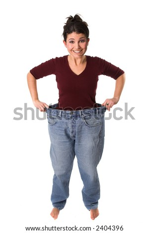 Pretty brunette wearing an old jeans from before she started to loose weight - stock photo