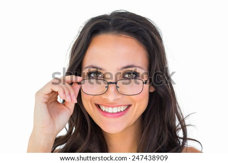 Pretty brunette wearing glasses on white background - stock photo