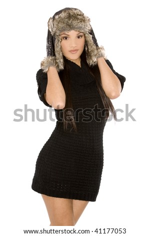 pretty brunette wearing winter outfit on white background