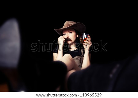 pretty  brunette with a cigar and whiskey in his hand - stock photo