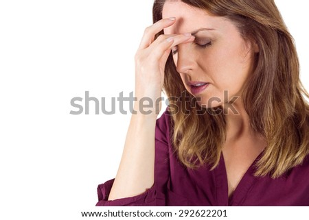 Pretty brunette with headache touching her forehead on white background - stock photo