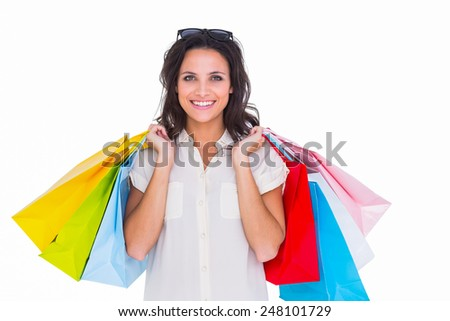 Pretty brunette with shopping bags on white background - stock photo