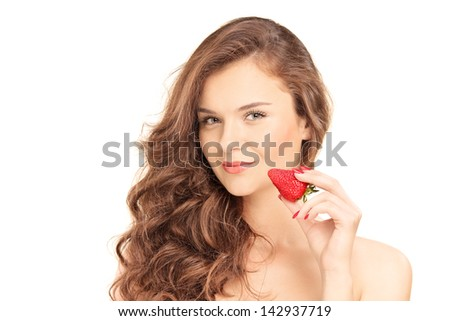 Pretty brunette woman holding a strawberry, isolated on white background - stock photo