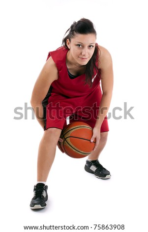 Pretty brunette woman holding Basketball in hand and smiling isolated on a white background - stock photo