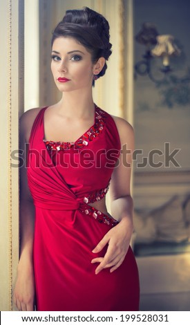 pretty brunette woman in a red dress - stock photo