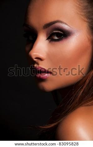pretty brunette woman on black background - stock photo