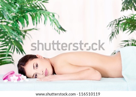 Pretty brunette woman resting after massage - stock photo