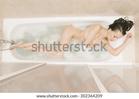 pretty brunette woman take a relaxing bath