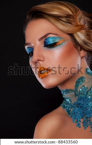 pretty brunette woman with bright creative make up