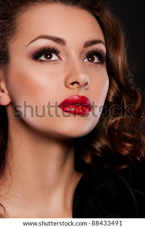 pretty brunette woman with magnificent red lips - stock photo