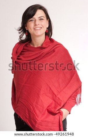 Pretty brunette wrapped in a cashmere red shawl - stock photo