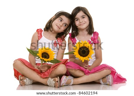 pretty brunettes twins sitting on white isolated background - stock photo