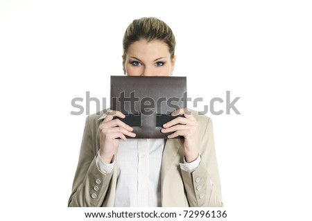 pretty buisnesswoman hiding behind a diary - stock photo