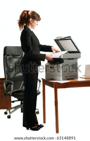 Pretty business lady or student copying documents - stock photo