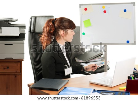 "Pretty business lady or student with a badge ""Boss"" working at a desk"