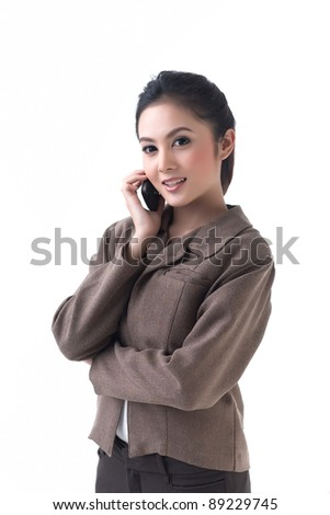 Pretty business woman is on the phone - stock photo