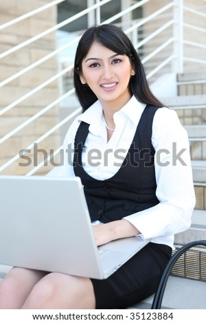 Pretty Business Woman on Stairs with Laptop Computer