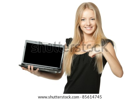 Pretty business woman pointing at notebook laptop screen with copy space over white background