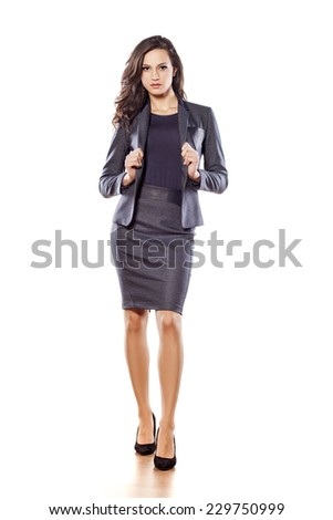 Pretty business woman posing on white background