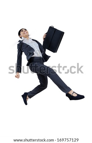 Pretty business woman running and jumping with briefcase